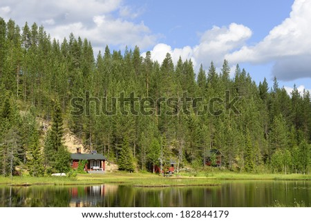 Northern landscape. Hill with pine forest and lake - stock photo