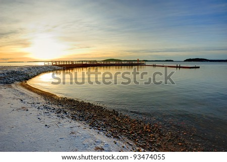 Northern landscape with quay in winter - stock photo