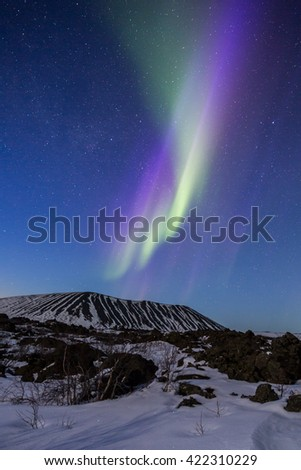Northern Lights above a crater in Iceland - stock photo