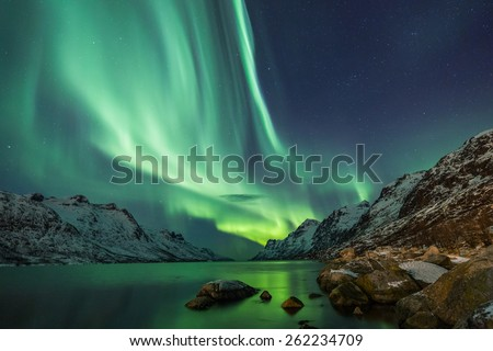 Northern Lights above waters edge - stock photo