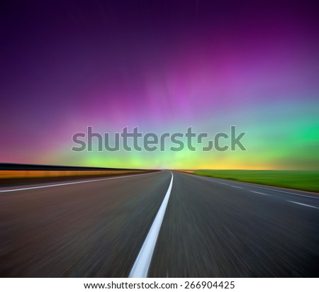Northern lights (Aurora borealis) on road. Russia. Izhevsk 17.03.2015 - stock photo