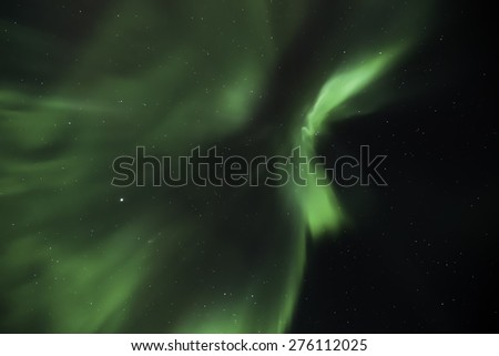 Northern lights in the night sky over Iceland in winter - stock photo