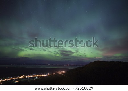Northern lights over Eagle River (foreground) and Wasilla (background), AK - stock photo