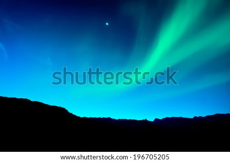 Northern lights over mountain - stock photo