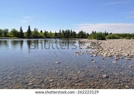 Northern river from the pebbly shores. Summer river landscape of the Polar Urals. - stock photo