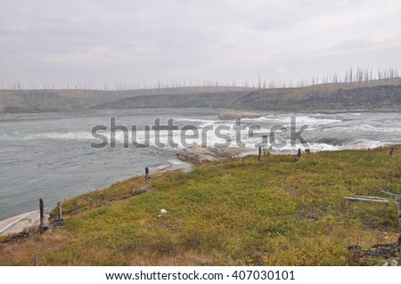 Northern river rapids. River banks with tundra on the Taimyr Peninsula.