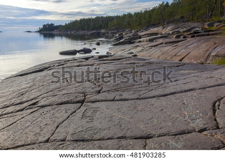 northern rocks on the shore of the White Sea and blue water