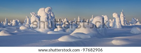 Northern Ural Mountains. Fantastic snow figures on trees. Frosty morning on border with Siberia. - stock photo