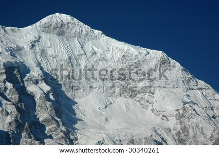 Northern wall of the Nilgiri mountain. Himalaya, Nepal. - stock photo