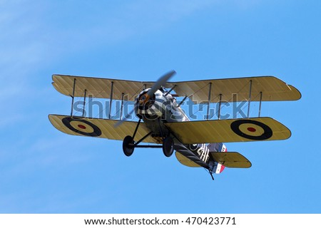 NORTHILL, UK - AUGUST 2: A replica Sopwith Snipe fighter aeroplane from the WW1 era prepares to land at the Old Warden airfield on August 2, 2015 in Northill.