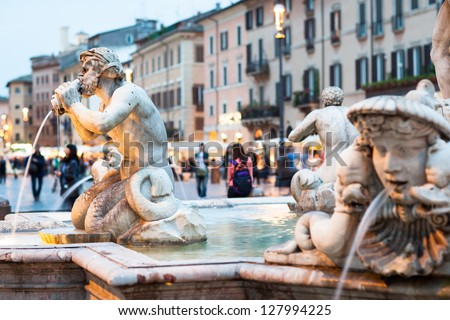 Northward view of the Piazza Navona with the fontana del Moro (the Moor Fountain) and the Sant'Agnese in Agone church at dusk - Rome, Italy - stock photo