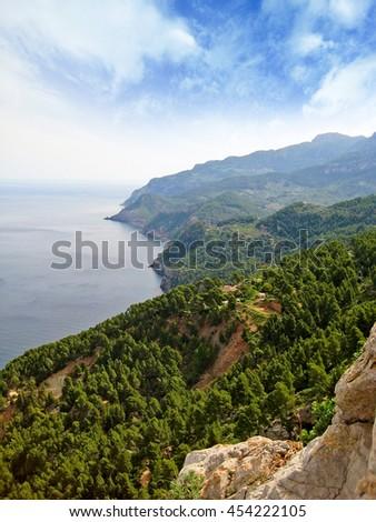 Northwest coast of Majorca, view from Tramuntana mountains towards coastline - stock photo
