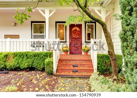 Northwest horse ranch with fall changing leaves and white fence. - stock photo