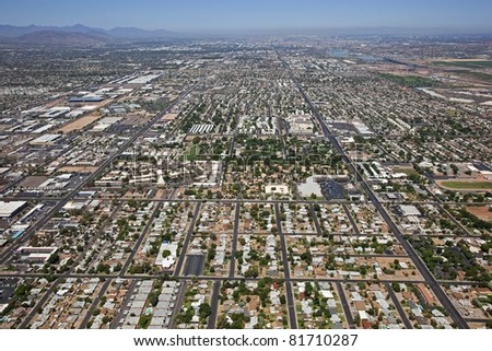 Northwest Mesa, Arizona with Tempe and Phoenix in the distance from above - stock photo