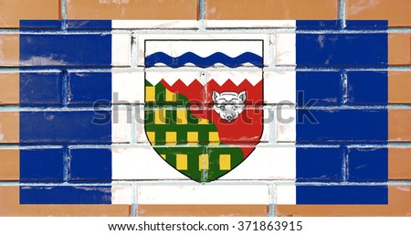 Northwest Territories flag painted on old brick wall texture background - stock photo