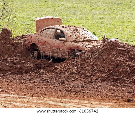NORTON, CANADA - SEPTEMBER 11: A junked car forms part of the bank at a demolition derby on September 11, 2010 in Norton, Canada.