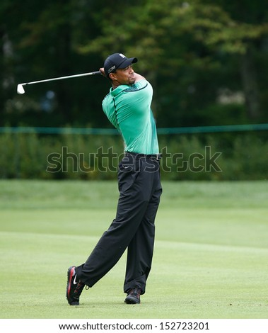 NORTON, MA-SEP 1: Tiger Woods hits a fairway shot during the third round at the Deutsche Bank Championship at TPC Boston on September 1, 2013 in Norton, Massachusetts.  - stock photo
