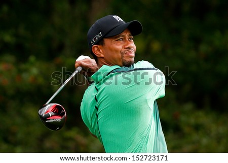 NORTON, MA-SEP 1: Tiger Woods tees off the fourth hole during the third round at the Deutsche Bank Championship at TPC Boston on September 1, 2013 in Norton, Massachusetts.  - stock photo