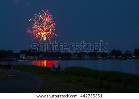 NORWALK, CONNECTICUT - JULY 3: Evening at park near downtown  bridge with people watching for 4th of July fireworks in Norwalk in July 3, 2015 in Norwalk, Connecticut. - stock photo