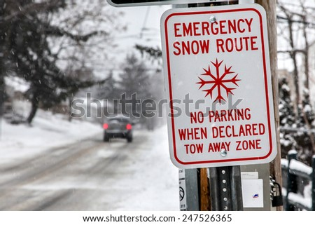NORWALK,CT - JANUARY 27:  Car on North Taylor Ave after winter storm in Norwalk on January 27, 2015 - stock photo