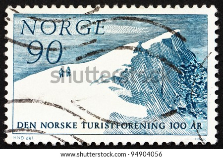 NORWAY - CIRCA 1967: a stamp printed in the Norway shows Glitretind Mountain Peak, Centenary of Norwegian Mountain Touring Association, circa 1967 - stock photo