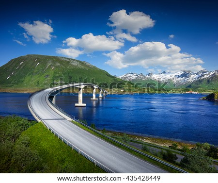 Norway famous bridge with mountains in background. Beautiful road over river in nature. - stock photo