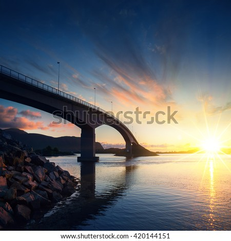Norway famous long bridge over sea / fjord at sunset. Pure nature at sunset