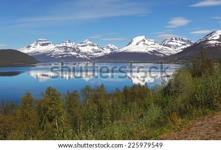 Norway fjord at spring near Tromso - stock photo