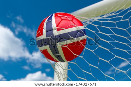 Norway flag and soccer ball, football in goal net - stock photo