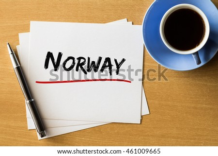 Norway - handwriting on papers with cup of coffee and pen, concept