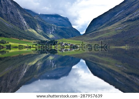 Norway - ideal fjord reflection in clear water - stock photo