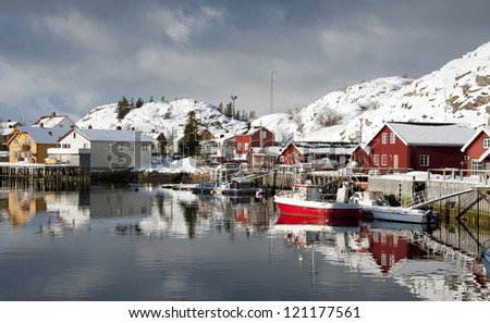 Norway in winter: mountains with colorful houses and the ocean on a sunny winter day in Lofoten islands - stock photo