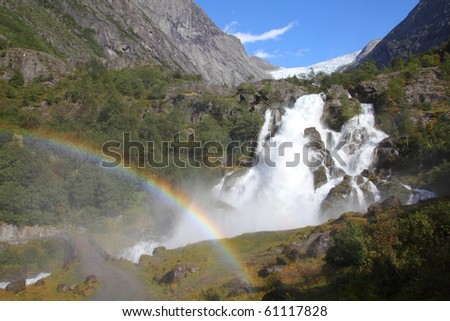 Norway, Jostedalsbreen National Park. Famous waterfall originating from Briksdalsbreen glacier in Briksdalen valley. - stock photo
