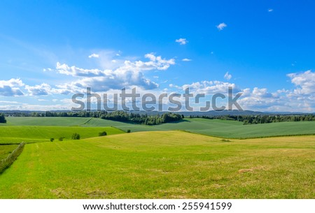 Norway landscape - fields, forest and sky - stock photo