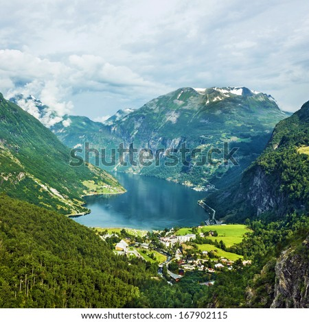 Norway landscape Mountains and village in Geiranger fjord. - stock photo