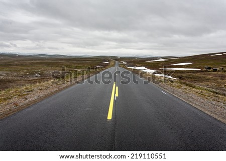 Norway landscape with lonely road and deep blue sky. - stock photo