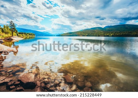 Norway Nature Fjord, Autumn Time. Cloudy Day, Landscape With Mountain, Pure Water Lake, Pond, Sea - stock photo