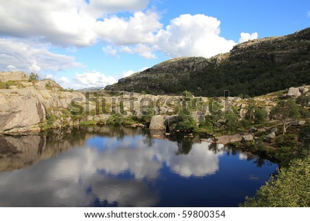 Norway, Rogaland county. Beautiful view of small lake from the trail to Preikestolen.
