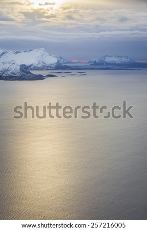 Norwegian aerial landscape: aerial view over the sea and snowy mountains, Norway - stock photo