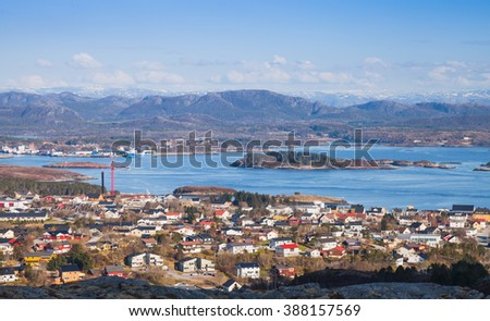 Norwegian fishing town Rorvik on the sea coast. Spring coastal landscape photo