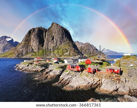 Norwegian fishing village huts with rainbow, Reine, Lofoten Islands, Norway  - stock photo