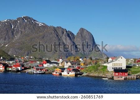 Norwegian fishing village with traditional red rorbu huts, Reine, Lofoten Islands, Norway - stock photo