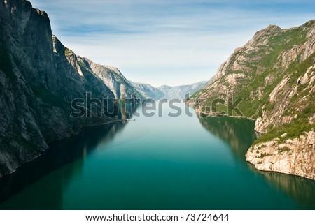 Norwegian fjord and mountains. Kjerag plateau, Lysefjord, Norway. - stock photo