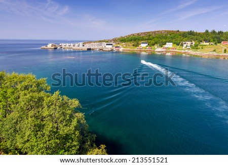 Norwegian fjord with driving boat - stock photo
