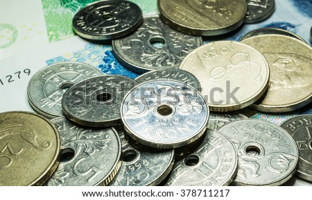 stock-photo-norwegian-krone-coin-and-ban