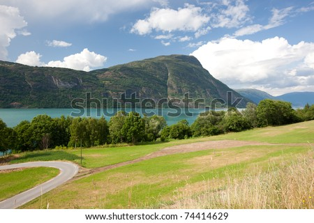 Norwegian landscape with fjord and mountains - stock photo