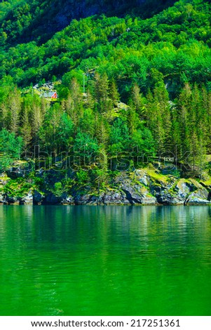 Norwegian red typical country house hytte in the mountains. Beautiful landscape in Norway, Scandinavia - stock photo