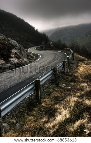 Norwegian road during misty weather - stock photo