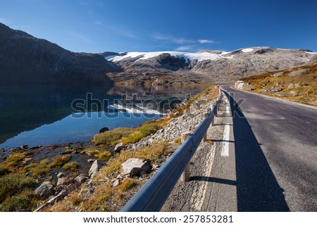 Norwegian road in mountains in autumn - stock photo