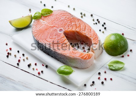 Norwegian salmon filet with spices over white wooden surface - stock photo